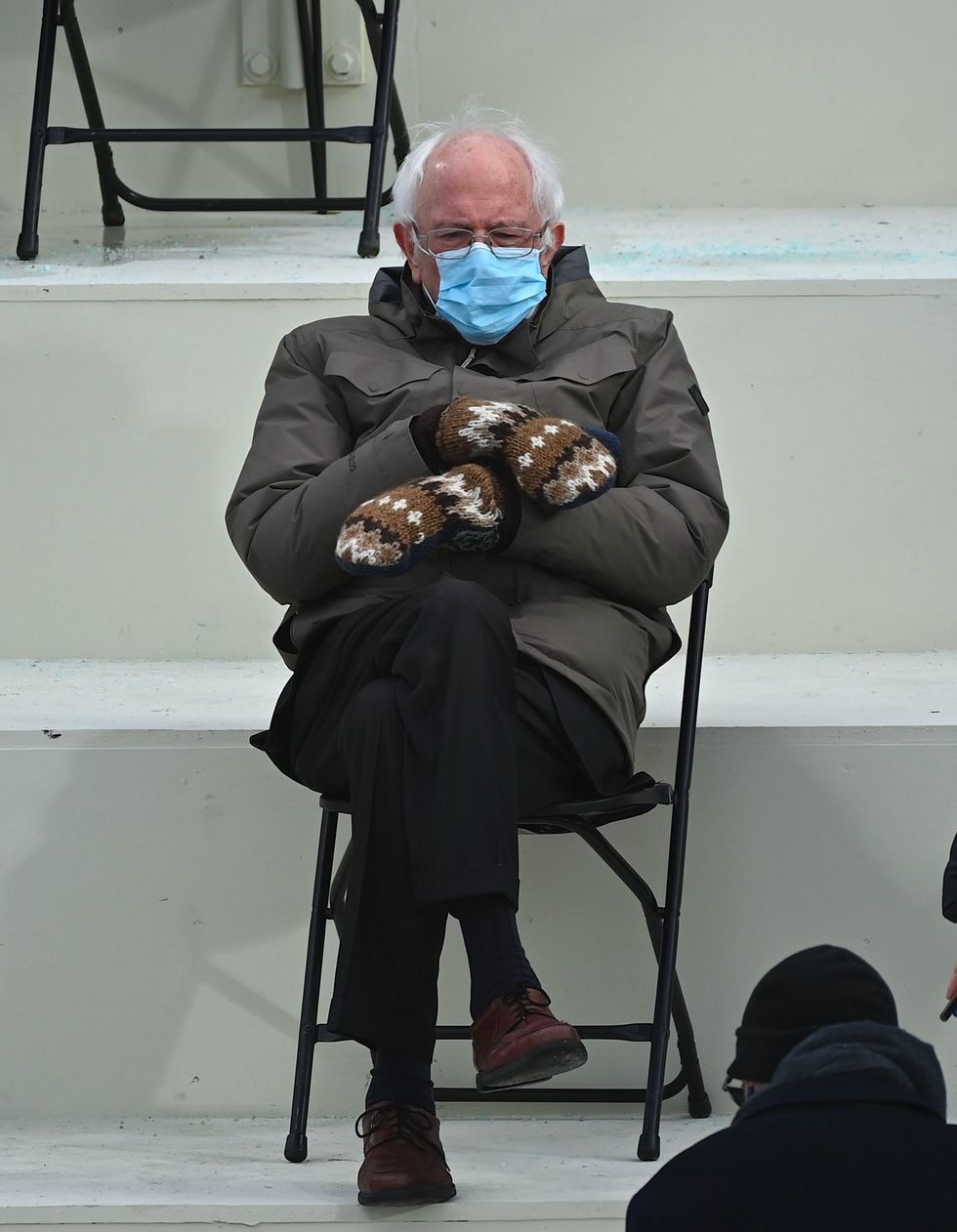 Bernie Sanders sits looking depressed at Biden's inauguration